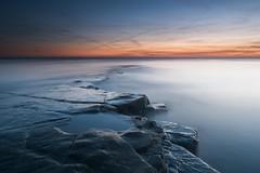 Kimmeridge Sunset (movinonagroove) Tags: sunset sunlight sea seascape bay kimmeridge kimmeridgebay ledge rock longexposure leefilter bigstopper blue orange evening dorset