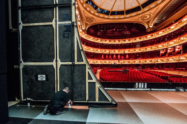 Backstage staff member works on stage turnaround for The Royal Opera's The Nose © ROH 2016. Photograph by Sim Canetty-Clarke.