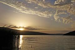 Pour Anne & Pierre (nathaliedunaigre) Tags: coucherdesoleil sunset lake lac lacdannecy paysage landscape eau water clouds nuages ciel sky reflets reflections or golden gold dor nature