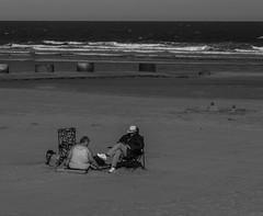 Beachwear (fishyfish_arcade) Tags: uk greatbritain sea england people blackandwhite bw white black beach monochrome blackwhite seaside sand nikon photos strangers lincolnshire northsea mablethorpe d3200