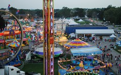 Overlooking the west end of the Walworth County Fair (Cragin Spring) Tags: summer usa wisconsin rural lights unitedstates unitedstatesofamerica fair rides countyfair wi smalltown elkhorn 2015 walworthcountyfair elkhornwi walworthcounty elkhornwisconsin