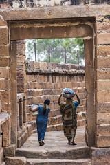 Cave Temple (Vilvesh) Tags: light people bw india architecture canon photography shadows karnataka hampi photograhy badami cwc canon100mm tokina1116mm chennaiweekendclickers cwctravelwalk