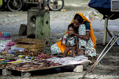 Mother's affection (Ranjith Kizhakoodan) Tags: world street travel autumn india love souvenirs nap alone affection fort crowd mother kerala vendor lonely tours kochi greenary northindian walktours