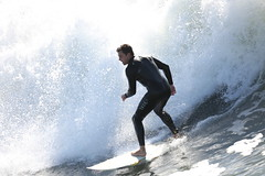 Huntington beach ca serfer (jack.dailey62) Tags: ocean california beach canon exploring huntington surfing longboard wetsuit saltwater pictureperfect bigwave surfup nationalgeographics thebestofflickr jackdailey62yahoocom surfingthepear