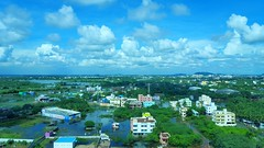 A flock of clouds on a sunny day in rain-battered Chennai. (Harish Kumar N) Tags: blue sky india white mountains green water grass clouds photography day view great sunny chennai