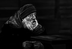 Face - exploring emotions #113 (Ales Dusa) Tags: street streetphoto streetportrait portrait face man homeless outdoor poverty misery apostle natgeo faces 1000faves canon5d people beard eating alesdusa canoneos5d emptytable poorman