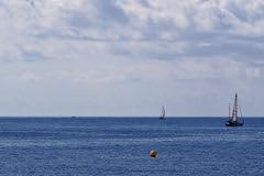 En pareja (Fnikos) Tags: sky skyline cloud light sea water seascape boat sailboat serene vehicle outdoor