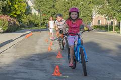 Bike Rodeo Slalom Course (aaronrhawkins) Tags: kids children bike bicycle rodeo course slalom cones boy girl concentration tongue neighbors nieghborhood race obstacle pary backtoschool provo utah fun balance joshua aaronhawkins
