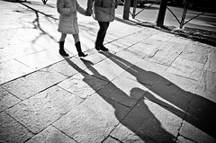 _DSC6755 (stimpsonjake) Tags: nikoncoolpixa 185mm streetphotography bucharest romania city candid blackandwhite bw monochrome holdinghands mother daughter shadows