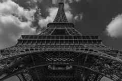 Eiffel Tower, Paris (Sorin Popovich) Tags: eiffeltower blackandwhite monochrome mono paris iledefrance france closeup lowangleview architecture clouds sky bw day frenchculture nopeople landmark majestic outdoors tower traveldestinations