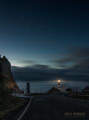BETWEEN THE SKY & THE EARTH (Emilio Rodríguez Álvarez) Tags: lighthouses faros paisaje marina sea mar nocturna estrellas cabo ortegal cariño coruña atlantico cantabrico vertical galicia canon eos 7d tokina iso800 night noche color