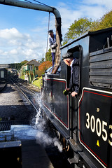 Watered up (skipnclick) Tags: steam engine train railway water hose swanage men