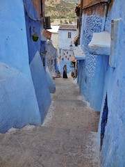 the girl at the bottom of the steps (SM Tham) Tags: africa morocco rifmountains chefchaouen thebluecity thebluepearl town street steps slope buildings walls rooftops hangingpots mountainside outdoors