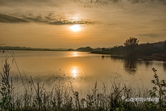 The Winter Sun (Alanchippyh) Tags: sunlight waterreflections watersunlight trees orange outdoor grey black clouds sky white sony77ii serene sunset