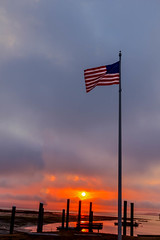 Symbol Of Freedom (http://fineartamerica.com/profiles/robert-bales.ht) Tags: blue sunset red sky usa cloud sunlight white yellow vertical america stars freedom flying photo democracy washington state symbol wind stripes flag united country scenic americanflag places pride flags pole national american states independence patriotism waving sunrisesunset celebrate fluttering haybales vibrantcolor seacape unitesstates longbeacharea robertbales