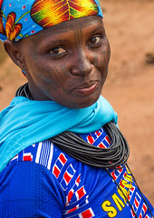 Benin, West Africa, Copargo, a beautiful tattooed fulani peul tribe woman (Eric Lafforgue) Tags: poverty africa portrait people woman color beauty vertical tattoo female rural outdoors necklace clothing women colorful pretty feminine muslim islam headscarf culture tribal tattoos westafrica nomad benin tradition tribe facial nomads oneperson fulani headwear headandshoulders headgear traditionalclothing peul onewomanonly lookingatcamera fula colourimage africanethnicity pastoralists 1people  copargo    benin4588