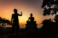 Silhouette Buddha statue and children (santifoto9) Tags: travel boy sunset sculpture heritage tourism face smart silhouette yellow statue sunrise computer children asian thailand temple gold golden big holding worship asia meditate sitting technology hand phone buddha traditional faith religion touch pad culture belief monk buddhism screen smartphone thai frame figure spirituality southeast spiritual wat siam touchpad phrabuddhachay