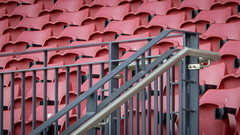 Red Stands (Theen ...) Tags: red black hot vertical metal stars lumix grey bars stainlesssteel day sunny plastic seats bannisters adelaide handrail folded curved oval stands cupholders theen