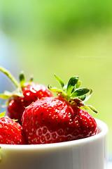 Top of the top (fotografkaa) Tags: light red summer food sun macro green closeup strawberry warm bokeh strawberries