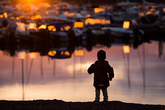 Adventures ahead (JuNu_photography) Tags: child childhood photooftheday adventure silhouette imagination mind sunset harbour color autumn fall reflection boats evening portrait portraiture 5d3 5d mark iii canon ef 135mm f2 shallow dof bokeh full frame beautiful world adventurous strong colors
