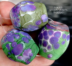 Rocks Green Violets Frosted (Laura Blanck Openstudio) Tags: openstudio openstudiobeads glass handmade murano lampwork torched beads bead set big artist art arts fine artisan made usa rocks pebbles stones frit whimsical funky odd earthy organic abstract colrful multicolor lilac grape lavender purple violet jewelry published show winner festival italian argentinian matte opaque etched glow frosted white enamel green olive copper mauve