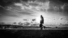 A man at sunset - Howth, Ireland - Black and white street photography (Giuseppe Milo (www.pixael.com)) Tags: streetphotography sun howth photograph sunset ireland street photography dublin blackandwhite candid monochrome countydublin ie onsale