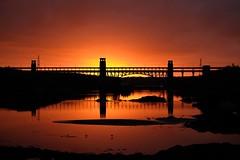 Britannia Sunset (dilys_thompson) Tags: bridge sunset menai menaistraits anglesey sky reflections reflection silhouettes silhouette sun autumn northwales lovelysky redskyatnight dusk