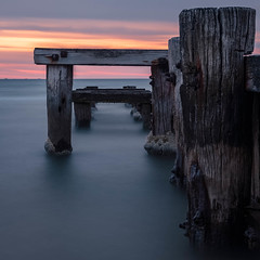 Abandoned (djryan78) Tags: wood landscape sunset sigma dslr australia outdoor canon dusk 6d abandoned portphillip cloud mentone seascape groyne spring bay canon6d 24105 clouds melbourne victoria derelict old water weathered barnacles longexposure mentonegroyne rot sigma24105 portphillipbay