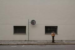 die gegen die Wand schauen, ob sie sich schmen (raumoberbayern) Tags: munich mnchen urbanfragments robbbilder abstract wand wall hydrant schild fenster windows sign school schule gehsteig trottoir strase street