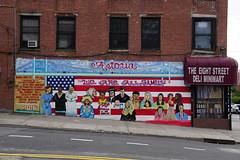 Welling Court Mural Project - Astoria, Queens, NYC (SomePhotosTakenByMe) Tags: eightstreetdeliminimart deli eightstreet shop store geschäft laden minimart flag flagge fahne usa urlaub vacation holiday nyc newyork newyorkcity america amerika queens astoria mural wandbild kunst art graffiti wellingcourt wellingcourtmuralproject muralproject outdoor weareallfamily wearefamily ronhall hall