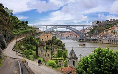 Untouched Porto just above the River Douro (Bn) Tags: porto oporto arteaosmolhos alley raining day rain tower architectural heritage portugal bell church strolling up climbing capital douro river city cluttered cobbled ascending decending local facades harbor tourism tourist walking port wines urban faades ambience old history unesco travel monastery sdoporto cathedral roman catholic cloister covered walk gallery decorations ceramic wisdom solomon pontelusi luizi bridge luiz electric tram domlusibridge metrodoporto rainy umbrella sandeman capelasradoalm vilanovadegaia decay ruin crucifix chapelofthelordofbeyond 50faves topf50 100faves topf100