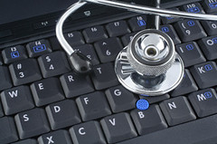 laptop and stethoscope (smaurya_q3) Tags: laptop notebook computer keyboard internet net technology black communication email equipment hardware office software surf web key type portable mobility stethoscope medicine medical tool clinic clinical diagnosis diagnose cure examine examining healthcare health object care closeup database hospital online doctor physician sick science repair