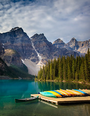 Moraine Lake (Loren Mooney) Tags: blue trees wild summer sky lake canada mountains green nature wet water clouds canon landscape rockies boats boat aqua natural august canoe alpine canoes banff wilderness peaks lakelouise morainelake canadianrockies 2015
