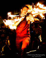 Dragon Staff Spinner (Paul Cory) Tags: lighting camera city summer people man male night season lens fire dance availablelight flames performance dancer event firedancing portfolio citystreet geolocation postprocessing firestaff fujicamera timeofday sparkcon niksoftware exif:make=fujifilm camera:make=fujifilm fujilens exif:aperture=28 circusspark colorefexpro4 circussparkfireconclave fujifilmxt1 exif:isospeed=3200 camera:model=xt1 exif:model=xt1 fujifilmxf50140mmf28rlmoiswr exif:focallength=744mm exif:lens=xf50140mmf28rlmoiswr danceperformanceportfolio sparkcon2015