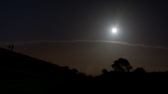 Hunter's moon with silhouettes of trees and people (Ian Redding) Tags: england huntersmoon nature sandpoint somerset uk autumnalequinox beautiful clouds coast coastline fullmoon harvestmoon hills landscape moon naturalbeauty night people reflected scenic silhouette silhouetted silverlining trees