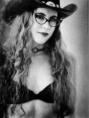 lilith0016a (EYEsnap_Photography) Tags: lilith blackandwhite portrait cateyeframes cateye glasses bra curlyhair cowgirl