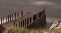 Derelict pier on the Craignish Peninsula (Graham Cameron Himself) Tags: abandoned alone beach blurredwater craignish derelict harbour headland landscape lightning longexposure mysterious oban peaceful pier rocks rust scotland sea seascape seaside simple simplicity storm unitedkingdom argyll uk gbr