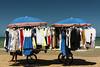 Un pò di ombra (Luca Maresca) Tags: mare spiaggia marocchino abiti vestiti vucumprà ombra sole ombrellone sabbia riva riposino riposo carretto relax sanmenaio gargano puglia estate 2016 blu cielo colori