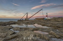 Morning Reflections. (Emily_Endean_Photography) Tags: portland dorset sunrise coast ocean reflections colours beauty beautiful lighthouse cranes structure architecture rocks nikon leefilters long longexposure exposure