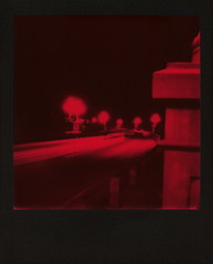 Red Suicide Bridge Nights (tobysx70) Tags: the impossible project tip polaroid slr680 frankenroid sx70 door rollers red black blackandred duochrome film for 600 type cameras instant blackframe impossaroid suicide bridge nights coloradostreetbridge colorado blvd boulevard route 66 rt rte pasadena california ca night nocturnal lighttrails lights lit illuminated curve toby hancock photography