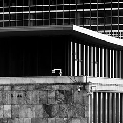 U.N. Surveillance (Mabry Campbell) Tags: 2012 houstonphotographer mabrycampbell manhattan ny nyc newyork newyorkcity newyorkcounty november us usa unitedstates unitedstatesofamerica architecturalphotography architecture architecturephotography building cameras commercialphotography editorialphotography fineartphotographer fineartphotography image monochrome photo photograph photographer photography security squarecrop surveillance f28 november102012 201211107855 200mm sec 200 ef200mmf28liiusm