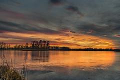 Strike of light 4 (piotrekfil) Tags: nature landscape water waterscape winter ice lake sunset sky clouds dusk twilight pentax poland piotrfil