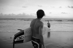 you can't stop the waves, but you can learn to surf (Alessandra Poli) Tags: surf bali indonesia youth young soul surfing waves bw