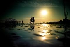 end of days (fotobes) Tags: sea people sun water sunshine silhouette reflections puddle lca brighton crane silhouettes westpier lowtide analogue seafront vignetting brightonbeach vignette goldenhour wetsand ratseyeview wetreflections i360 kodakektar100
