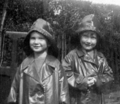 The girls in their new raincoats (theirhistory) Tags: girl kid child rubber raincoats mackintosh souwester hatcoar
