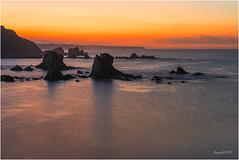Los guardianes del silencio (El color del cristal) Tags: longexposure sea costa seascape luz sol contraluz de landscape atardecer mar rocks asturias paisaje land contraste puesta contra largaexposicin playadelsilencio