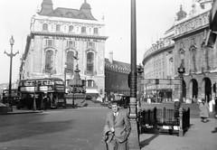 Piccadilly Circus, 1940s (vintage ladies) Tags: street people blackandwhite man bus london car statue vintage underground tie suit 40s