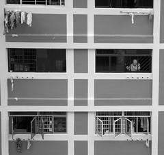 Einsamkeit, loneliness (frank.gronau) Tags: white black frank fenster sony 7 alpha frau einsamkeit schwarz singapur hochhaus weis gronau