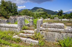 The ruins of the old temple (Ivanov Andrey) Tags: temple archaeology ruins history religion paganism ancientgreece column step stone wall stairs horizon sky cloud blue god stovetop sand trip journey midday summer heat sun mountain hill slope peak landscape travel peloponnese greece