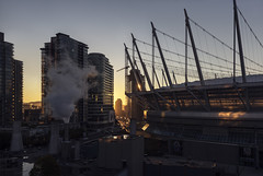 Morning at the stadium (andre adams) Tags: stadium bcplace sunrise morning sun urban architecture cars cityscape smoke highrise lighting cinematic condo backlit canada bc vancouver britishcolumbia